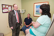 Goetz H. Kloecker, MD, photographed Monday, Sep. 28, 2015, sees patient Devona Hayes and her husband Tim Hayes at the James Graham Brown Cancer Center in Louisville, Ky.