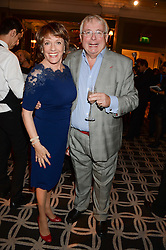 ESTHER RANTZEN and CHRISTOPHER BIGGINS at the 90th birthday party for Nicholas Parsons held at the Hyatt Churchill Hotel, Portman Square, London on 8th October 2013.