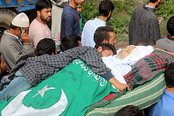 July 19, 2017 - Anantnag, Jammu and Kashmir, India - Relative hugs dead body of civilian, Mohammad Abdullah Ganai at Village Hassanpora in Bijbehara some 40 kilometres south of Kashmir. Ganai, succumbed to his injuries at SKIMS Soura Tuesday after being injured as Army men allegedly opened fire in Bijbehara town on Monday afternoon during an altercation with the locals. (Credit Image: © Muneeb Ul Islam/Pacific Press via ZUMA Wire)