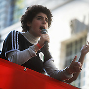 Tens of thousands took to the streets in Central London taking part in the the Global Climate Strike, September 20th 2019, London, United Kingdom.  Noga, one of the organisers adresses the crowd. The day of strike for the climate was a global event with millions taking part across the globe. The strike was inspired by Greta Thunberg, a Swedish school girl who started the first school strike for the climate. Her action inspired school children across the world to go on strike demanding radical climate change policies to save their future. On September 20th adults aand children alike went out on strike to demand radical political change and climate justice. The day included speeches and a march through central London.
