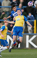 Photo: Steve Bond/Sportsbeat Images.<br />Macclesfield Town v Hereford United. Coca Cola League 2. 26/12/2007. Martin Gritton (higher) gets a header in above Lee Collins
