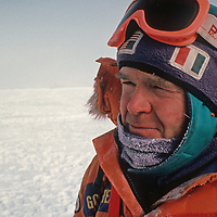 Polar explorer Will Steger looks at a vast horizon beyond the South Pole, about halfway through the 1989-1990 Trans-Antarctica Expedition.