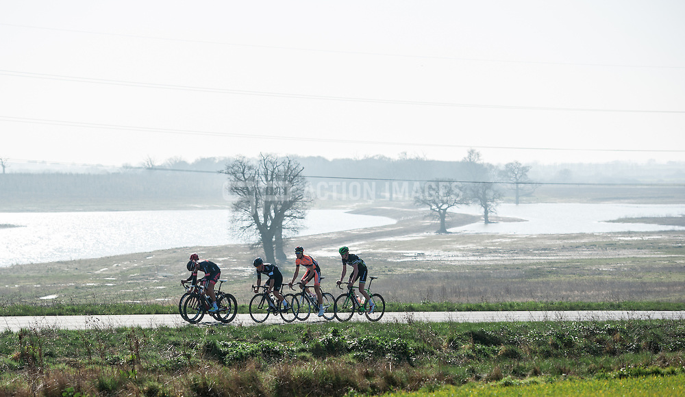 The leading group of five cross Abberton Reservoir during the Jock Wadley Road Race, Layer, Colchester, UK on 09 March 2014. Photo: Simon Parker