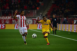 December 5, 2017 - Athens, Attiki, Greece - Alex Sandro (no 12) of Juventus pass the ball, under the pressure of Felipe Pardo (no 90) of Olympiacos. (Credit Image: © Dimitrios Karvountzis/Pacific Press via ZUMA Wire)