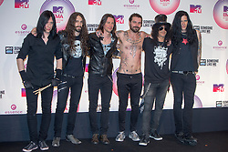 Myles Kennedy (3L), Simon Neil (3R) and Slash (2R) with the rest of the band, backstage at the winners room MTV EMA, Glasgow.