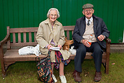 Spectators take a break between the many, many activities on offer.  The hairdryers are out and the shampoo is flowing at the Great Yorkshire Show, one of Britain's biggest agricultural shows. Its famous for its competitive displays of livestock. The event, established in 1837, attracts over 125 000 visitors a year and has over 10 000 entries to its pedigree competitions ranging from pigeons and rabbits to bulls and shire horses. At the heart of the show is the passion of the exhibitors who spend hundreds of hours ( and pounds)  training, preparing and grooming their animals.