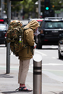 A man wearing  a large backpack is seen in the CBD during the COVID-19 in Melbourne. With over a week of zero cases in Victoria, Premier Daniel Andrews is expected to make major announcements on Sunday about further easing of restrictions. (Photo by Dave Hewison/Speed Media)