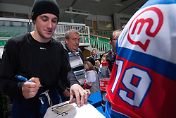 Jaka Ankerst of Slovenia signing autographs to the fans at ice-hockey match between Slovenia and Kazakhstan, on April 12, 2011 at Hala Tivoli, Ljubljana, Slovenia. (Photo By Matic Klansek Velej / Sportida.com)
