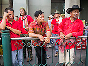19 MAY 2013 - BANGKOK, THAILAND:  Red Shirt supporters wait for a Red Shirt rally honoring people killed by the Thai Army in 2010 to start in Bangkok. More than 85 people, most of them civilians, were killed during the Thai army crackdown against the Red Shirt protesters in April and May 2010. The Red Shirts were protesting against the government of Abhisit Vejjajiva, a member of the opposition who became Prime Minister after Thai courts ruled the Red Shirt supported government was unconstitutional. The protests rocked Bangkok from March 2010 until May 19, 2010 when Thai troops swept through the protest areas arresting hundreds.   PHOTO BY JACK KURTZ