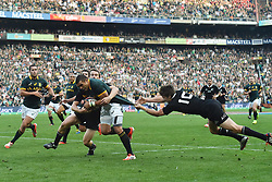 04/10/2014. All Blacks players try to tackle Bryan Habana of the Springboks during the test match held at Ellis Park Stadium. <br /> <br /> Picture: Masi Losi