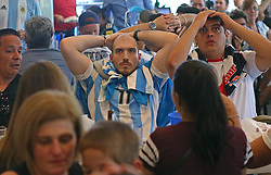 June 21, 2018 - Miami Beach, FL, USA - Juan Gamero, a fan of Argentina's national soccer team, reacts after Croatia scores the third goal as he watches a television broadcast of the Russia 2018 World Cup match between Argentina and Croatia at Manolo on Thursday, June 21, 2018 in Miami Beach, Fla. Croatia won 3-0. (Credit Image: © David Santiago/TNS via ZUMA Wire)