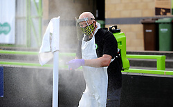 Forest Green Rovers staff spray the corner flags and posts at half-time - Mandatory by-line: Nizaam Jones/JMP - 05/09/2020 - FOOTBALL - New Lawn Stadium - Nailsworth, England - Forest Green Rovers v Leyton Orient - Carabao Cup