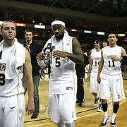 Central Florida guard A.J. Rompza (3), Central Florida guard Marcus Jordan (5) and Central Florida guard Isaac Sosa (11) leave the court after their game against Louisiana at the UCF Arena on December 15, 2010 in Orlando, Florida. UCF won the game79-58. (AP Photo/Alex Menendez)