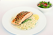 Backed salmon on rice with lemon sauce