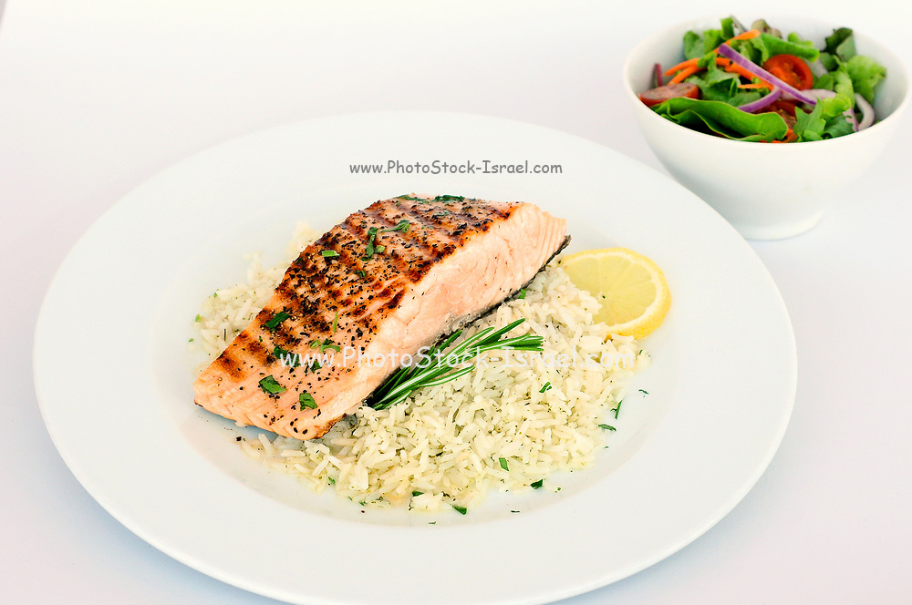 Backed salmon on rice with lemon sauce