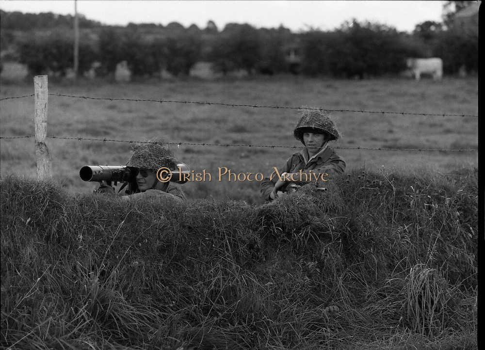 """Army Exercises In Co Sligo.   (L37).<br /> 1977.<br /> 05.09.1977.<br /> 09.05.1977.<br /> 5th September 1977.<br /> The Army Reserve Brigade, which is made up of regular units from the Southern Command, are conducting a series of conventional military exercises in counties Mayo and Sligo from the 5th to the 9th September. Approximately 1,500 men and 250 vehicles are involved. The exercise was codenamed """"Humbert"""" after an ill fated expedition by French troops into Ireland on 23rd August 1798. 1,100 French troops with Irish support took on the incumbent English forces. After some initial success they were defeated at Ballinamuk on 8th Sept 1798 by the army of Cornwallis.<br /> Picture shows some soldiers taking up position during the military exercises."""
