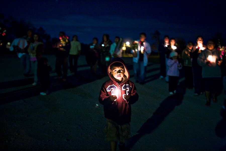 A young boy leads the candle-lit procession down the road to the factory for the Fiesta de la Hispanidad, commemorating the coronation of the Virgen de Guadalupe as queen of the hispanic world at Hudson Valley Foie Gras in Ferndale, New York on October 11, 2008. Some of the workers and their families, practically all Mexican immigrants, live on the grounds of the factory in company provided housing; a small, isolated Mexican community flourishes in the Catskills.