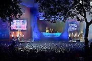 Nederland, Nijmegen, 13-7-2014 Matrixx at the park in het Hunnerpark. Onlosmakelijk met de vierdaagse, 4daagse, zijn in Nijmegen de vierdaagse feesten, de zomerfeesten. talrijke podia staat een keur aan artiesten, voor elk wat wils. Een week lang elke avond komen tegen de honderdduizend bezoekers naar de binnenstad. De politie heeft inmiddels grote ervaring met het spreiden van de mensen, het zgn. crowd control. Op de foto het podium van dicotheek,the Matrixx, voor house en dance. Hier word veel gebruik gemaakt van laserstralen voor de lichtshow.. De vierdaagsefeesten zijn het grootste evenement van Nederland. Foto: Flip Franssen/Hollandse Hoogte