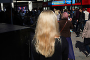 Woman with blonde hair out on Oxford Street which is the busiest shopping district in London, England, United Kingdom.