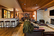 Remodeled Lower Level by Kathleen Poirier Architects with Limestone Bar and Fireplace