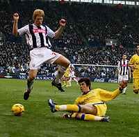 Photo: Mark Stephenson.<br />West Bromwich Albion v Southampton. Coca Cola Championship. 10/02/2007.West Brom's Kevin Phillips is slide tackled by Southampton's Gareth Bale