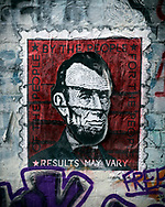 """In Hosier Lane, an alley famous for its graffiti art in Melbourne, Australia, one artist has created a postage stamp of Abraham Lincoln with the words """"of the people, by the people, for the people"""" and """"results may vary.""""<br /><br />(Melbourne, Australia - August 2017)"""