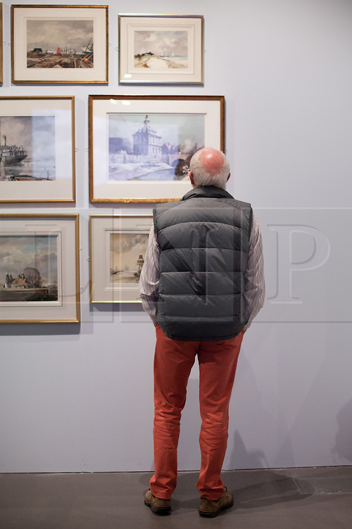 """@Licensed to London News Pictures 09/10/2015.Chatham, Kent. An eclectic selection of fine art by leading advocate of English lanscapes in winter  of distinguished English painter Rowland Hilder OBE PPRI RSMA opens tomorrow 10/10/15 at Chatham Historic Dockyard gallery in Chatham Kent. Included in the collection are illustrations from Moby Dick, Treasure Island, The Bible and unseen and banned  """"risque"""" illustrations Like Precious Bane.    Photo credit: Manu Palomeque/LNP"""
