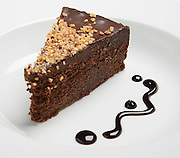Chocolate Cake with nuts on white