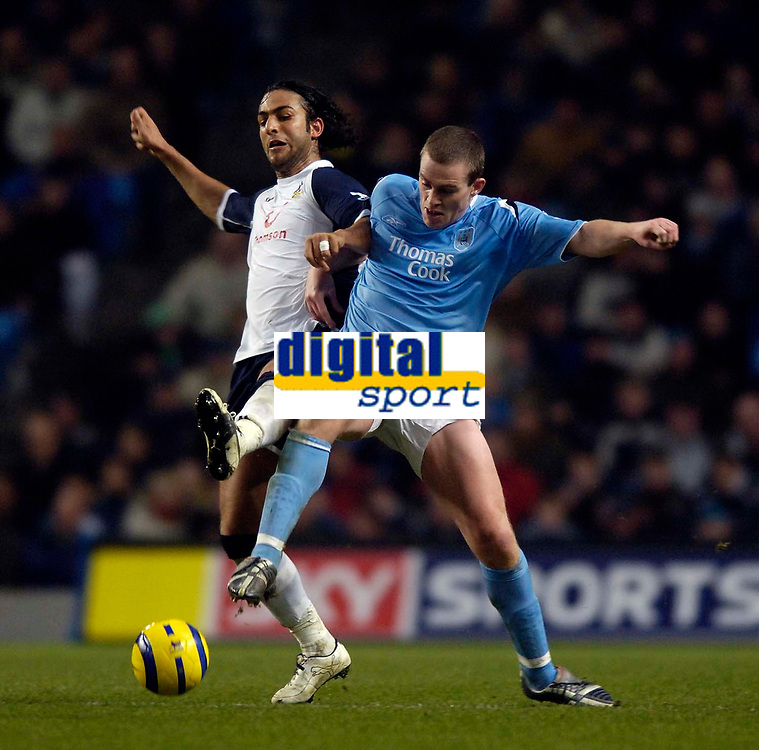 Photo: Jed Wee.<br /> Manchester City v Tottenham Hotspur. The Barclays Premiership. 04/01/2006.<br /> <br /> Tottenham's Mido (L) loses out to Manchester City's Richard Dunne.