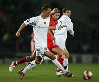 Photo: Paul Thomas.<br /> Blackburn Rovers v Basle. UEFA Cup. 02/11/2006.<br /> <br /> Reto Zanni (L) of Basel tries to out run Robbie Savage (Red).