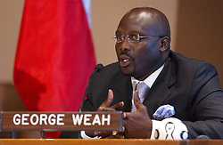 File photo : Liberian soccer star and former presidential candidate George Weah reacts during the 'Fight Against AIDS International Drug Purchase Facility' press conference at the United Nations Headquarters in New York, on Friday, June 2, 2006. Former football star George Weah has been elected as Liberia's president. Mr Weah is well ahead of opponent Joseph Boakai with more than 60% of the vote. Photo by Nicolas Khayat/ABACAPRESS.COM
