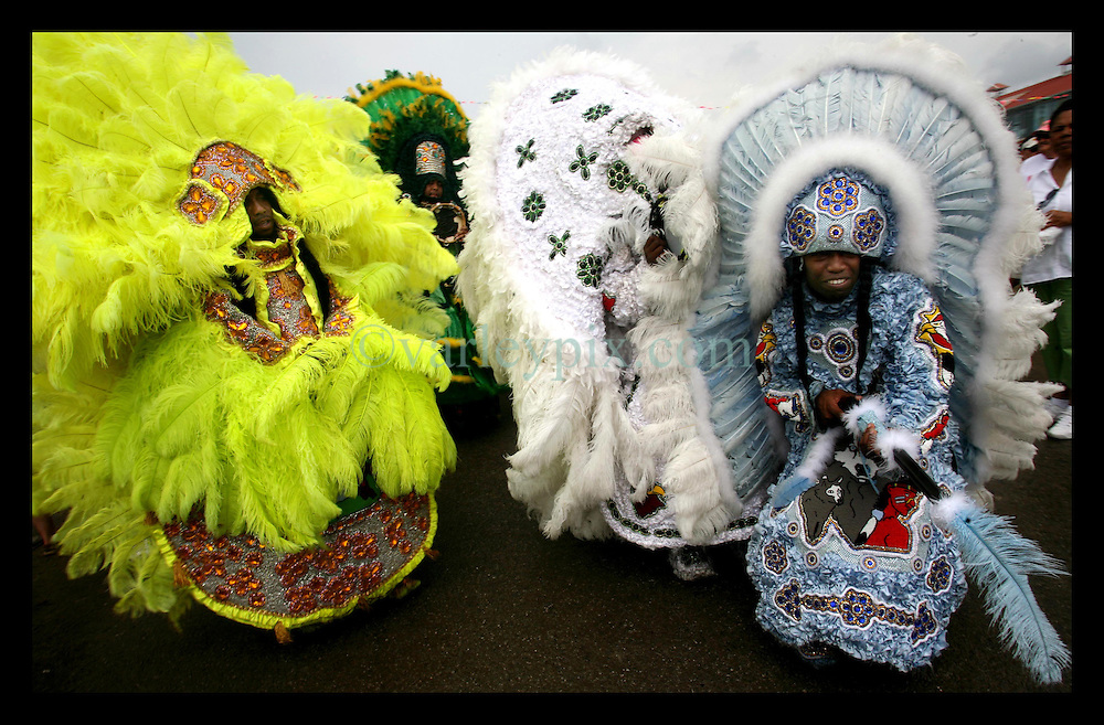 May 7th, 2006. New Orleans, Louisiana. Jazzfest . The New Orleans Jazz and Heritage festival. Members of the Wild Magnolias Mardi Gras Indians amongst the crowd.