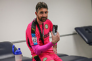 Forest Green Rovers goalkeeper Sam Russell(23) relaxing with a beer during the Vanarama National League Play Off Final match between Tranmere Rovers and Forest Green Rovers at Wembley Stadium, London, England on 14 May 2017. Photo by Shane Healey.
