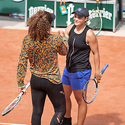 PARIS, FRANCE May 26. Naomi Osaka of Japan and Ashleigh Barty of Australia after practicing together on Court Philippe-Chatrier in preparation for the 2021 French Open Tennis Tournament at Roland Garros on May 2pm 6th 2021 in Paris, France. (Photo by Tim Clayton/Corbis via Getty Images)