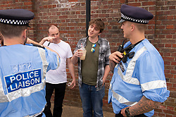 © Licensed to London News Pictures. 22/05/2019.<br /> Rochester,UK. Police standing with men holding iced coffee.  Brexit Party leader Nigel Farage in Rochester, Kent on the eve of the European elections tomorrow. Nigel had to stay on the campaign bus over fears of remainers with iced coffee.Photo credit: Grant Falvey/LNP