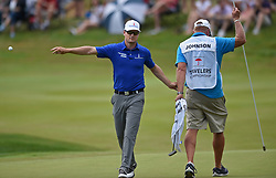 June 24, 2018 - Cromwell, CT, USA - After sinking a birdie putt, Zach Johnson throws his ball into the pond on the 17th hole during the final round of the Travelers Championship at TPC River Highlands in Cromwell, Conn., on Sunday, June 24, 2018. (Credit Image: © Brad Horrigan/TNS via ZUMA Wire)