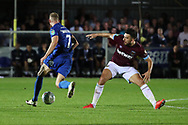 AFC Wimbledon midfielder Scott Wagstaff (7) beating West Ham United midfielder Robert Snodgrass (11) during the EFL Carabao Cup 2nd round match between AFC Wimbledon and West Ham United at the Cherry Red Records Stadium, Kingston, England on 28 August 2018.