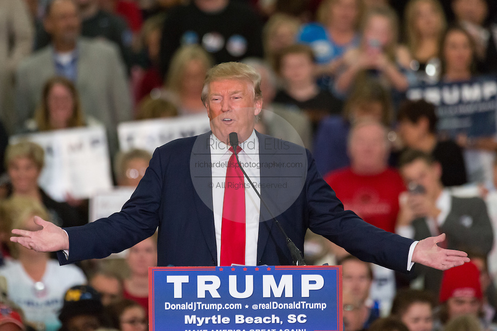 Republican presidential candidate billionaire Donald Trump addresses supporters during a campaign rally at the Myrtle Beach Convention Center November 24, 2015 in Myrtle Beach, South Carolina.