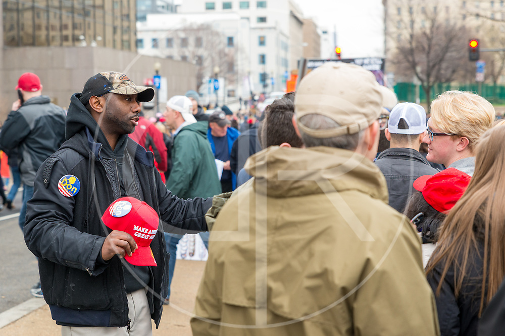 Washington DC, United States - A street vendor solicits a sale on the day of Donald J. Trump's inauguration.
