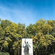 A wide shot of the statue and blue sky at the Theodore Roosevelt Memorial in Arlington, Virginia, just across the Potomac from the National Mall and Georgetown in Washington DC.