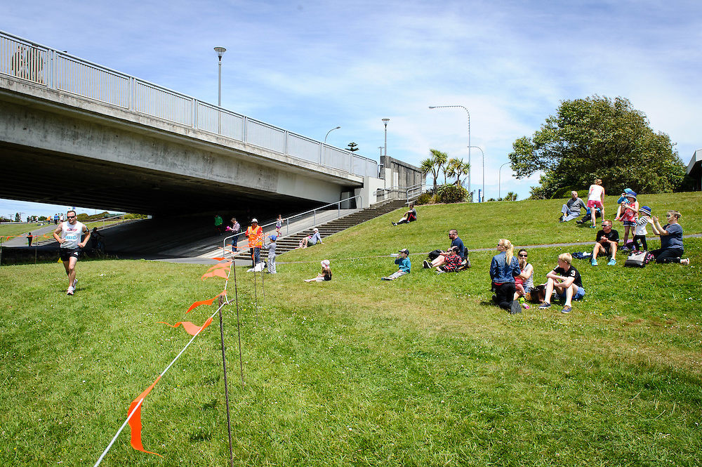 WELLINGTON, NEW ZEALAND - November 30:  A runner comes in to the finish chute a the end of the 1/2 marathon fun run at the Hutt River Festival November 30, 2014 in Ewan Bridge, Hutt City, New Zealand.  Interislander River Festival.  (Photo by Mark Tantrum/ real-people.co.nz)