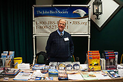 Observed portrait of Jim Huff smiling at the John Birch Society information table at the New Code of the West Conference held at the Grouse Mountain Lodge in Whitefish, Montana, USA, October 13, 2018.