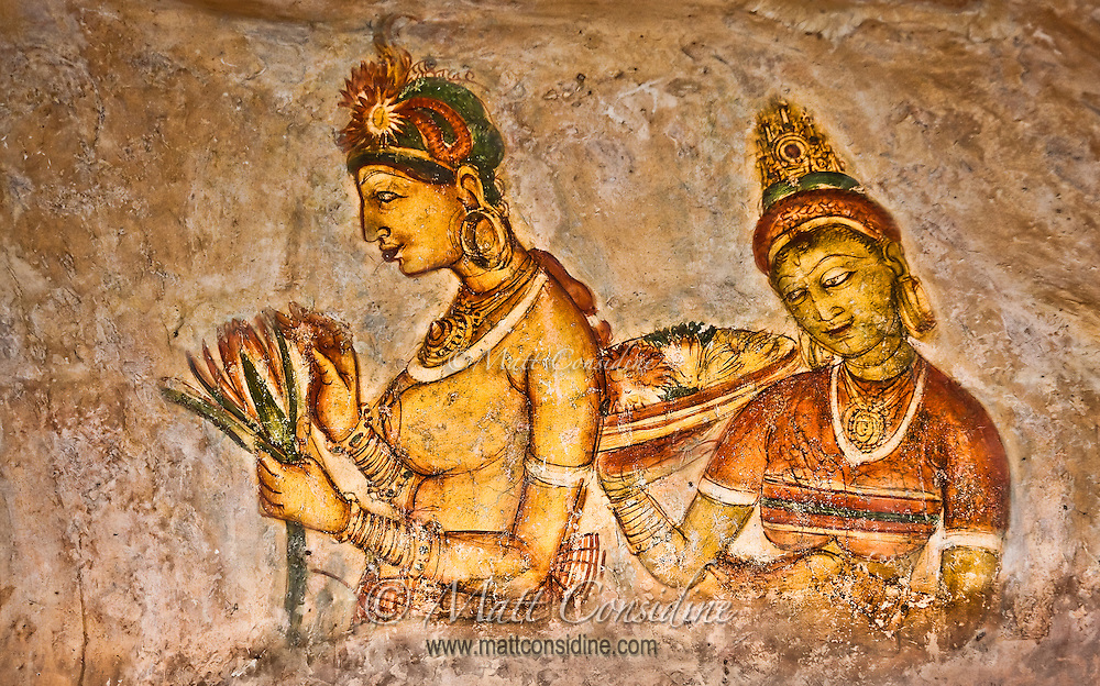 Half way up the face of a sheer cliff the monks painted colorful frescoes of women.<br /> (Photo by Matt Considine - Images of Asia Collection)