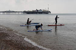© Licensed to London News Pictures. 31/05/2014. Brighton, UK. A group of students taking lessons in paddle boarding on Brighton Beach. The weekend is expected to reach temperatures of 20C down the South Coast according to the MET office. Photo credit : Hugo Michiels/LNP