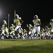 ORLANDO, FL - OCTOBER 09:  The UCF Knights run onto the field prior to the start of an NCAA football game at Bright House Networks Stadium on October 9, 2014 in Orlando, Florida. (Photo by Alex Menendez/Getty Images) *** Local Caption ***UCF Knights