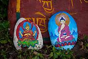Mantras painted on rocks at the Dalai Lama's temple, Dharamsala, Himachal Pradesh, India