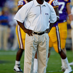 October 16, 2010; Baton Rouge, LA, USA; LSU Tigers running back coach Frank Wilson watches during warm ups prior to kickoff of a game against the McNeese State Cowboys at Tiger Stadium. LSU defeated McNeese State 32-10. Mandatory Credit: Derick E. Hingle