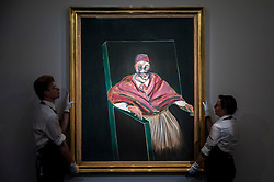 "© Licensed to London News Pictures. 19/06/2015. London, UK. Sotheby's staff show Francis Bacon's ""Study for Pope I"" (est. £25m - £35m), at Sotheby's Impressionist, Modern & Contemporary Art preview, ahead of the sale on 24 June 2015. Leading the sale are Kazimir Malevich's, ""Suprematism, 18th Construction"" and Edouard Manet's ""Le Bar aux Folies-Bergère"".  Photo credit : Stephen Chung/LNP"