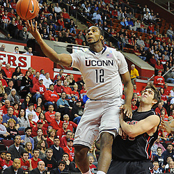 Connecticut Huskies center Andre Drummond (12) lays in a basket over Rutgers Scarlet Knights forward Gilvydas Biruta (55) during Rutgers' 67-60 upset victory over #8 UConn in NCAA Big East Basketball action at the Louis Brown Athletic Center in Piscataway, N.J. on Jan 7, 2012.