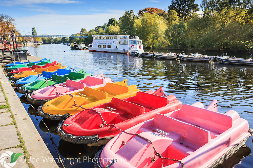 It's October, the season has ended and colourful pleasure boats are tied up along the riverside, in The Groves, Chester.